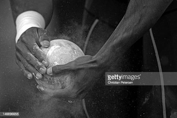 Brian Clay puts chalk on his shot put during the shot put portion of the decathlon during Day One of the 2012 US Olympic Track Field Team Trials at...