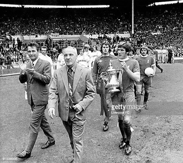 Brian Clough manager of Leeds United applauds Bill Shankly manager of Liverpool as they walk out before the FA Charity Shield match between Liverpool...