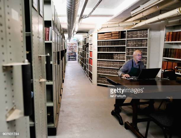 Brian Cole a bookbinder responsible for the maintenance of the books sits at his computer inside the Leeds Library on January 9 2018 in Leeds England...
