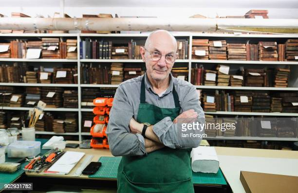 Brian Cole a bookbinder responsible for the maintenance of the books stands in his workshop inside the Leeds Library on January 9 2018 in Leeds...