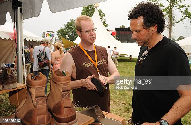 Brian Coleman of Timberland shows Harmonica player Mickey Raphael the summer musthaves and about the brand's Earthkeeper Network on June 13 2008 at...