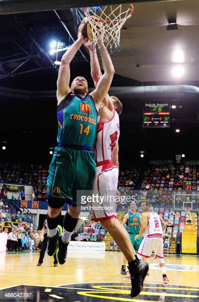 Brian Conklin of the Crocodiles attempts a jump shot over David Gruber of the Hawks during the round 16 NBL match between the Townsville Crocodiles...