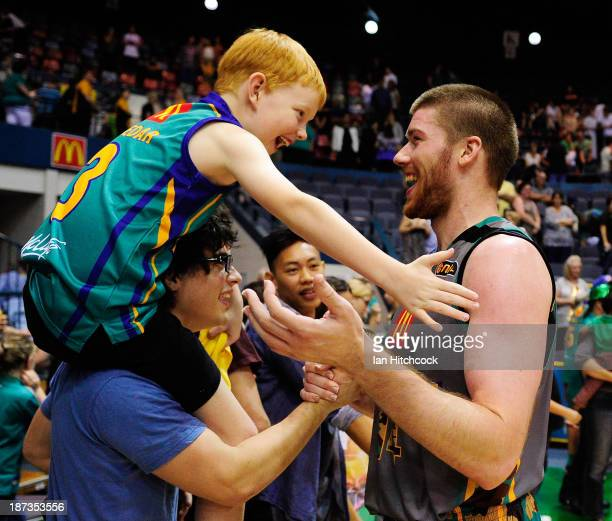 Brian Conklin of the Crocodiles celebrates witha fan after winning the round five NBL match between the Townsville Crocodiles and the New Zealand...