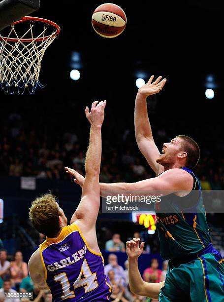 Brian Conklin of the Crocodiles takes a shot over Tom Garlepp of the Kings during the round four NBL match between the Townsville Crocodiles and the...