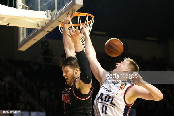 Brian Conklin of the Hawks and Harry Froling of the 36ers challenge for a rebound during the round 13 NBL match between the Illawarra Hawks and the...
