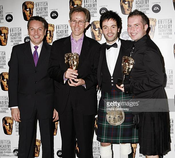 Brian Conley presents Matthew Napier and Paul Hineman from the crew of 'Raven' with the Entertainment award in the awards room at the 11th British...