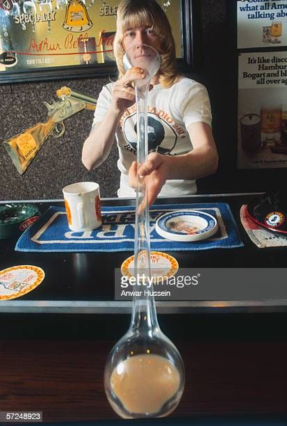 Brian Connolly lead singer of Sweet downs a yard of ale at the bar circa 1975