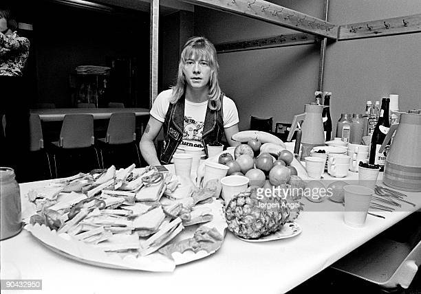 Brian Connolly of The Sweet poses backstage with a rider of sandwiches and fruit in April 1975 in Copenhagen Denmark