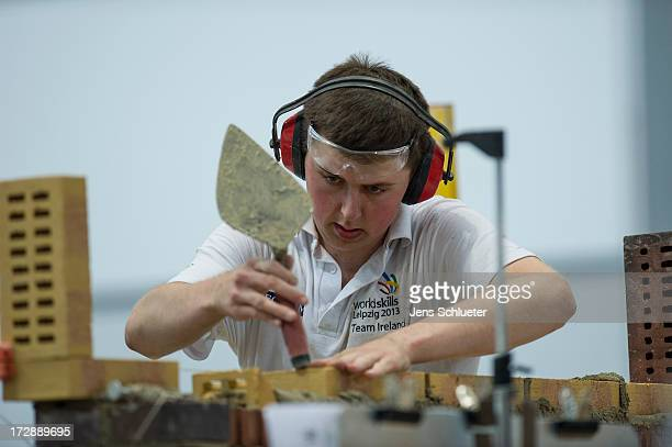 Brian Conville from Ireland competes in the category bricklaying at the Worldskills Leipzig 2013 international youth jobs skills competition on July...