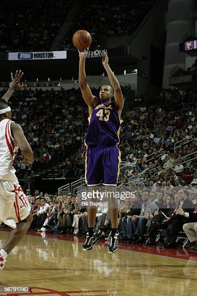 Brian Cook of the Los Angeles Lakers shoots over Stromile Swift of the Houston Rockets on February 8 2006 at the Toyota Center in Houston Texas NOTE...