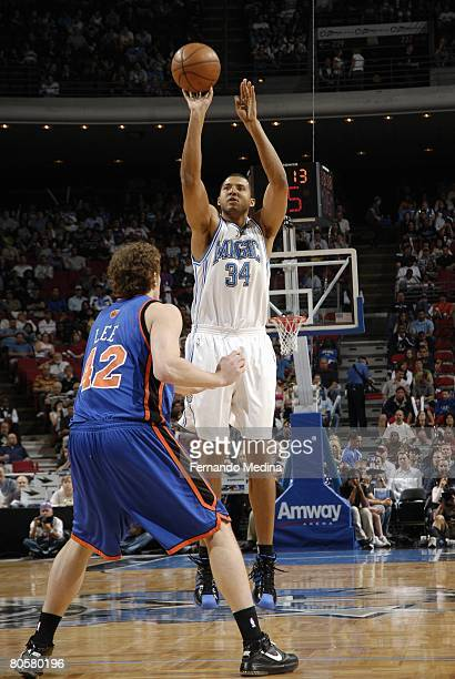 Brian Cook of the Orlando Magic shoots against David Lee of the New York Knicks during the game at Amway Arena on March 1 2008 in Orlando Florida The...