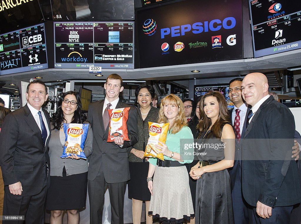 Brian Cornell, Christina Abu-Judom, Tyler Raineri, Indra Nooyi, Karen Weber-Mendham, Eva Longoria and Michael Simon pose for a photo during the NYSE Celebrates Lay's 'Do Us a Flavor' Contest Finalists during the opening bell at New York Stock Exchange on February 12, 2013 in New York City.