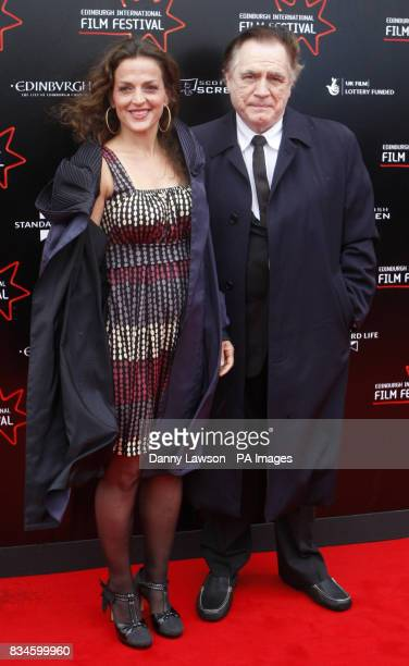 Brian Cox and wife Nicole AnsariCox arrive at the world premiere of Stone of Destiny part of the Edinburgh International Film Festival at Cineworld...