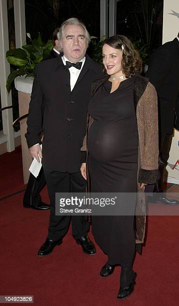 Brian Cox and wife Nicole arriving at the AFI Awards 2001 at the Beverly Hills Hotel in Beverly Hills, California
