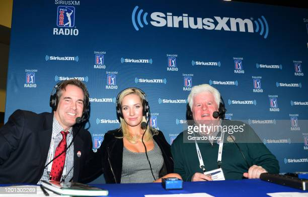 Brian Crowell Paige Spiranac and Frank Darby pose at the PGA Merchandise Show on January 22 2020 in Orlando Florida