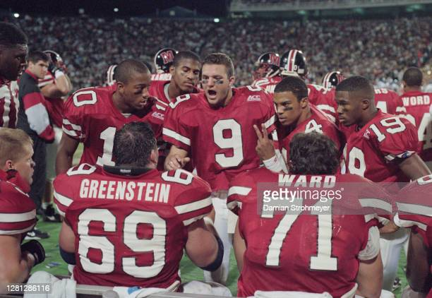 Brian Cummings, Quarterback for the University of Maryland Terrapins talks with his offensive line Eric Greenstein, #71 Pat Ward, #4 Jermaine Lewis...