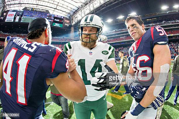 Brian Cushing and Jonathan Grimes of the Houston Texans talks at midfield after the game with Ryan Fitzpatrick of the New York Jets at NRG Stadium on...