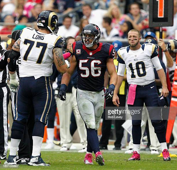 Brian Cushing of the Houston Texans and Jake Long of the St Louis Rams exchange words at Reliant Stadium on October 13 2013 in Houston Texas