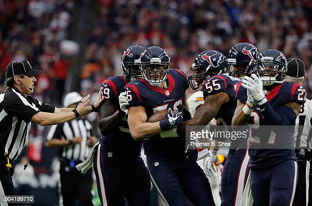 Brian Cushing of the Houston Texans celebrates his interception in the first quarter against the Kansas City Chiefs during the AFC Wild Card Playoff...