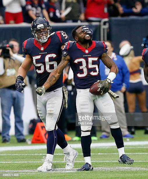 Brian Cushing of the Houston Texans celebrates with Eddie Pleasant after Pleasant intercepted a pass in the fourth quarter against the New York Jets...