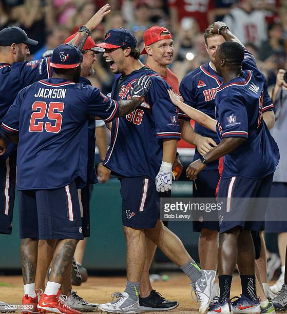 Brian Cushing of the Houston Texans celebrates with teammates after hitting a home run in the JJ Watt Charity Softball Classic at Minute Maid Park on...
