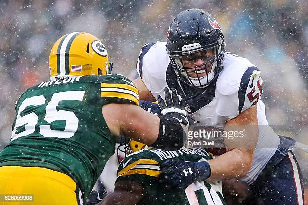 Brian Cushing of the Houston Texans fights off a block attempt by Lane Taylor and Ty Montgomery of the Green Bay Packers in the third quarter at...