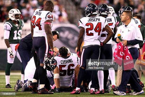 Brian Cushing of the Houston Texans is tended to after he was injured against the New York Jets at MetLife Stadium on October 8 2012 in East...