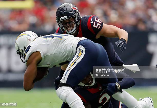 Brian Cushing of the Houston Texans looks to make the tackle against Tyrell Williams of the San Diego Chargers in the third quarter at NRG Stadium on...