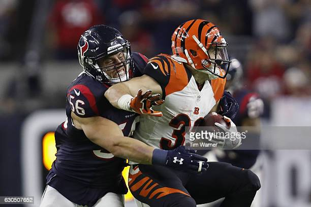 Brian Cushing of the Houston Texans tackles Rex Burkhead of the Cincinnati Bengals in the fourth quarter at NRG Stadium on December 24 2016 in...