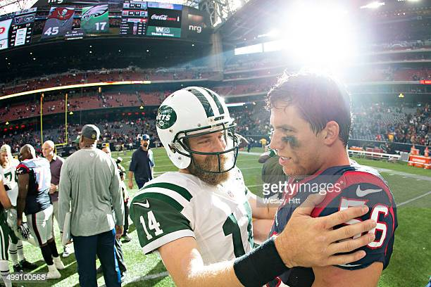 Brian Cushing of the Houston Texans talks at midfield after the game with Ryan Fitzpatrick of the New York Jets at NRG Stadium on November 22 2015 in...