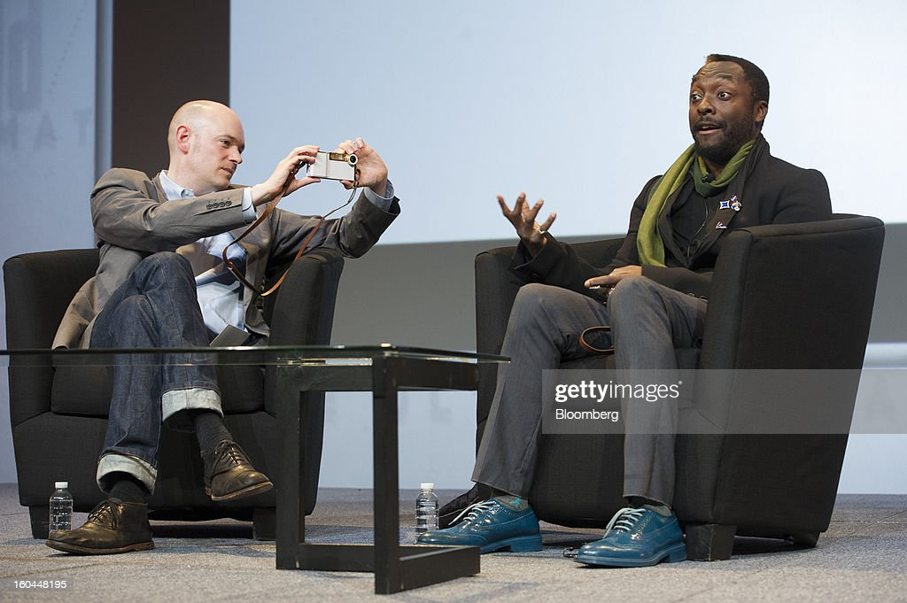 Brian David Johnson, futurist at Intel Corp., left, takes a photo of recording artist Will.i.am with the I.am+ foto.sosho case for the Apple Inc. iPhone as he speaks at the Macworld/iWorld conference at the Moscone Center West in San Francisco, California, U.S., on Thursday, Jan. 31, 2013. This year's conference, titled 'The Ultimate iFANEvent,' brings together attendees to celebrate Apple Inc. technology and learn more about products and services for Apple users. Photographer: David Paul Morris/Bloomberg via Getty Images