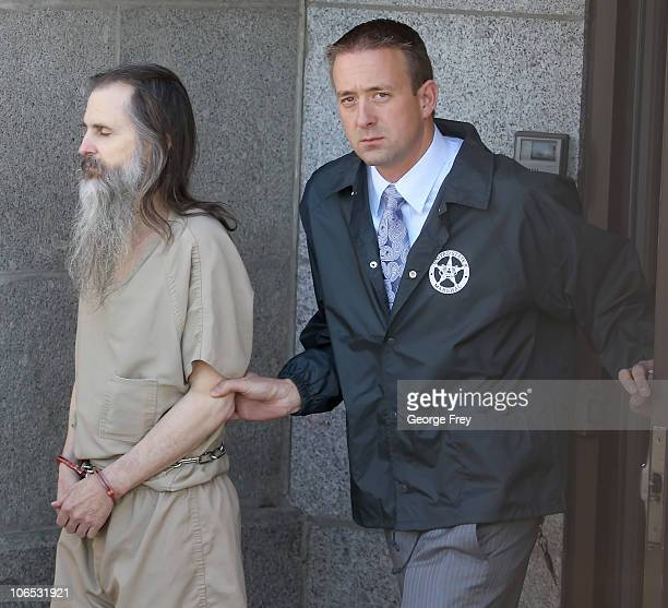 Brian David Mitchell alleged kidnapper of Elizabeth Smart is led out of Federal Court by a federal marshall to a waiting car on November 4 2010 in...