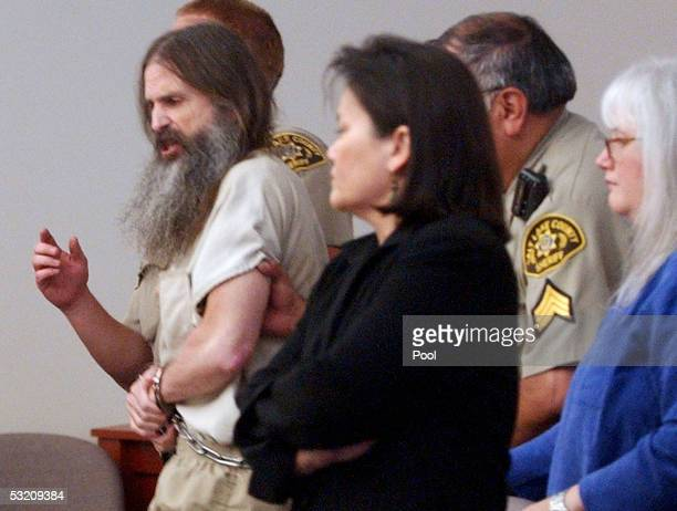 Brian David Mitchell is escorted out of 3rd District Court of Judge Judith Atherton during his competency hearing after shouted a Biblical admonition...