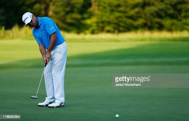 Brian Davis putts for birdie on the ninth hole during the first round of the Deutsche Bank Championship at TPC Boston on August 30, 2013 in Norton,...