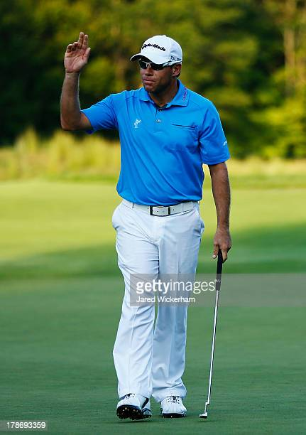 Brian Davis reacts after putting for birdie on the ninth hole during the first round of the Deutsche Bank Championship at TPC Boston on August 30,...