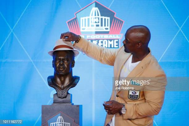 Brian Dawkins poses with his bust during the 2018 NFL Hall of Fame Enshrinement Ceremony at Tom Benson Hall of Fame Stadium on August 4 2018 in...