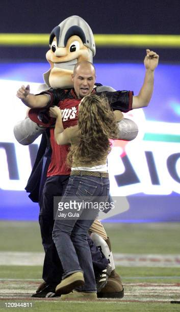 Brian Diesbourg is embraced by his girlfriend after kicking a 50 yard field goal at halftime to win $1 Million in Wendy's Kick for a Million contest...