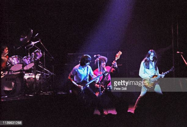 Brian Downey Gary Moore Phil Lynott and Scott Gorham of Thin Lizzy perform on stage at Hammersmith Odeon on April 27th 1979 in London United Kingdom