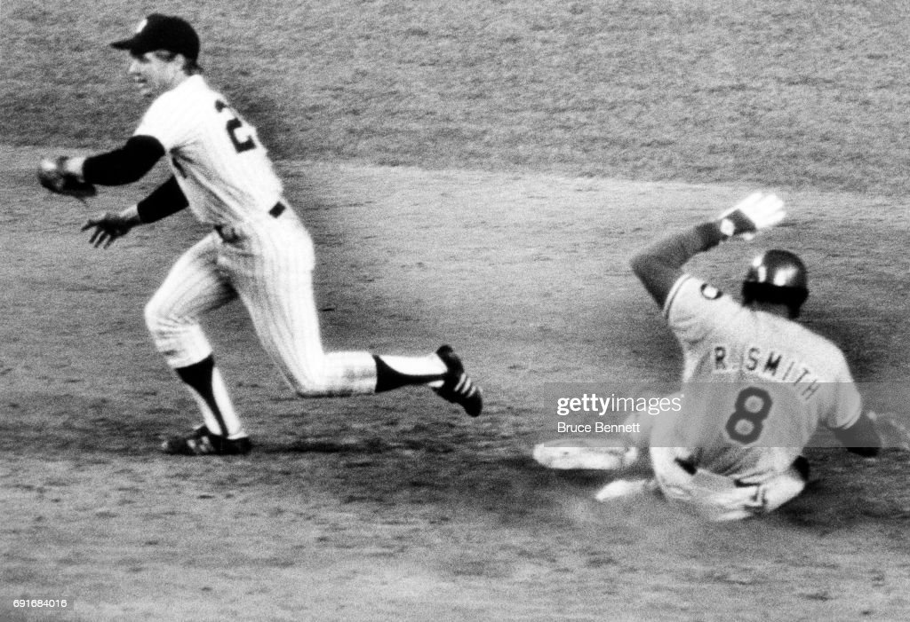 Brian Doyle #25 of the New York Yankees makes the catch as Reggie Smith #8 of the Los Angeles Dodgers is forced out at second during Game 3 of the 1978 World Series on October 13, 1978 at Yankee Stadium in the Bronx, New York.
