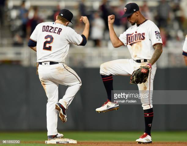Brian Dozier and Byron Buxton of the Minnesota Twins celebrate defeating the Detroit Tigers 60 on May 22 2018 at Target Field in Minneapolis Minnesota