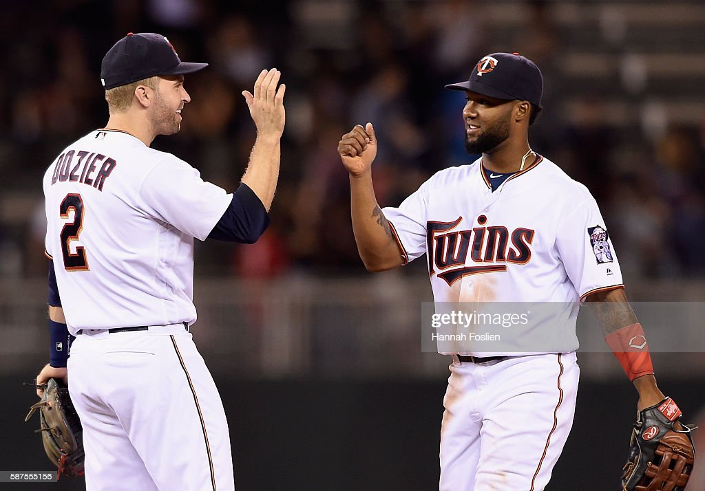 Brian Dozier #2 and Danny Santana #39 of the Minnesota Twins celebrate winning the game against the Houston Astros on August 8, 2016 at Target Field in Minneapolis, Minnesota. The Twins defeated the Astros 3-1.