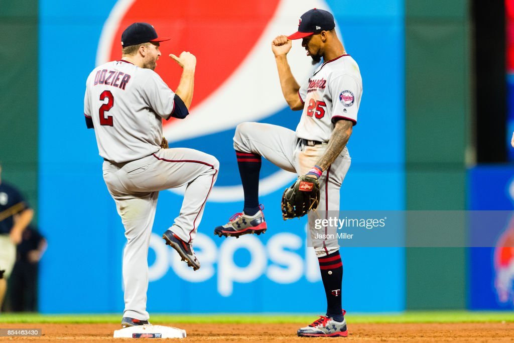 Brian Dozier #2 celebrates with Byron Buxton #25 of the Minnesota Twins after the Twins defeated the Cleveland Indians at Progressive Field on September 26, 2017 in Cleveland, Ohio. The Twins defeated the Indians 8-6.