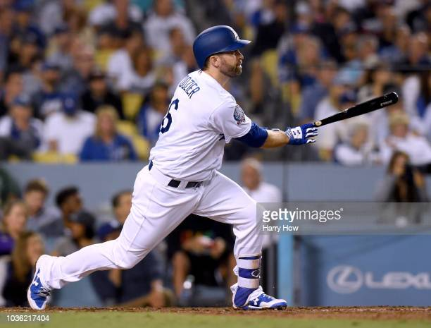 Brian Dozier of the Los Angeles Dodgers hits a double to score Enrique Hernandez to tie the game 22 with the Colorado Rockies during the fifth inning...