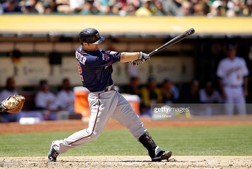 Brian Dozier #2 of the Minnesota Twins bats against the Oakland Athletics at O.co Coliseum on August 10, 2014 in Oakland, California.