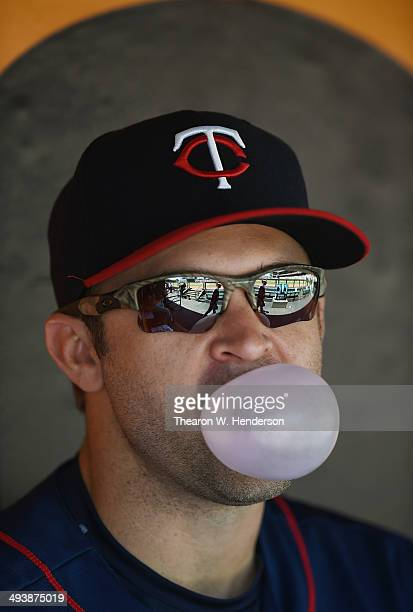 Brian Dozier of the Minnesota Twins blows bubble with bubble gum in the dugout prior to the start of his game against the San Francisco Giants at ATT...