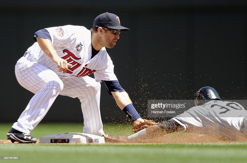 Brian Dozier #2 of the Minnesota Twins catches Alejandro De Aza #30 of the Chicago White Sox stealing second base during the fifth inning of the game on July 27, 2014 at Target Field in Minneapolis, Minnesota.