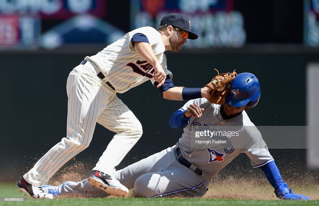 Brian Dozier #2 of the Minnesota Twins catches Teoscar Hernandez #37 of the Toronto Blue Jays stealing second base =d8 of the game on May 2, 2018 at Target Field in Minneapolis, Minnesota. The Twins defeated the Blue Jays 4-0.