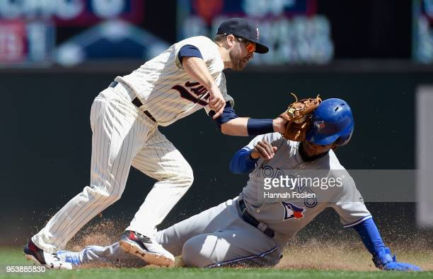 Brian Dozier of the Minnesota Twins catches Teoscar Hernandez of the Toronto Blue Jays stealing second base =d8 of the game on May 2 2018 at Target...