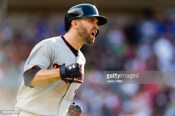 Brian Dozier of the Minnesota Twins celebrates as he rounds the bases on a solo home run to take the lead during the eighth inning against the...