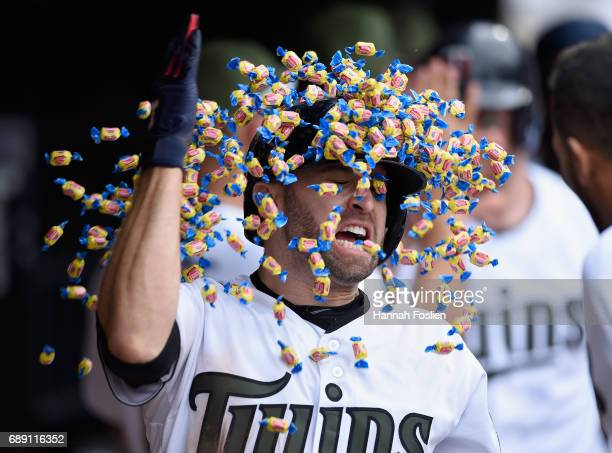 Brian Dozier of the Minnesota Twins celebrates hitting a tworun home run against the Tampa Bay Rays during the eighth inning of the game on May 27...